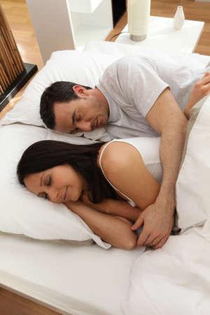 sleeping at desk: High-angle shot of a couple sleeping