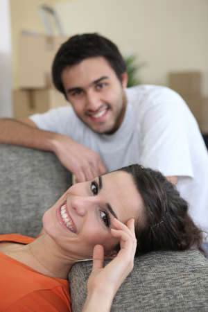 Couple laying on sofa after long day photo