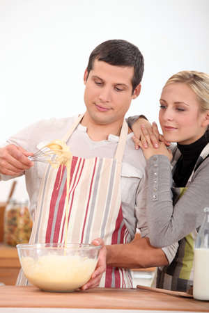 Couple cooking photo
