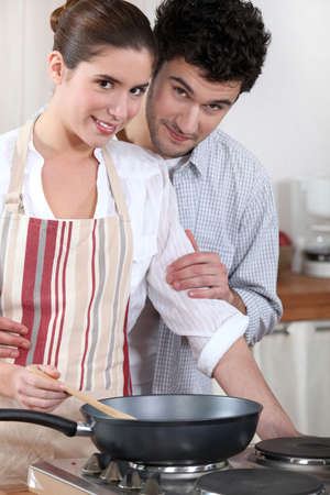 Couple cooking in their kitchen photo