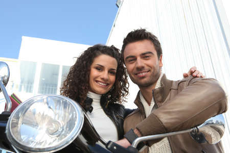 motor bike: Couple sat on scooter Stock Photo