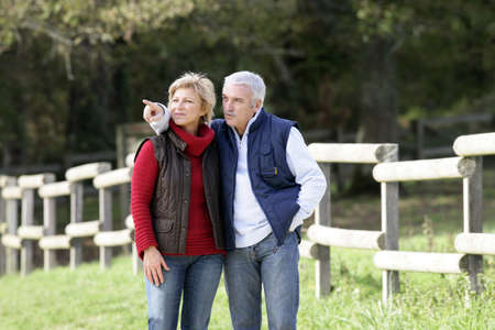 50 55: Couple spotting an animal in the countryside Stock Photo