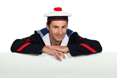 Man wearing sailor uniform photo