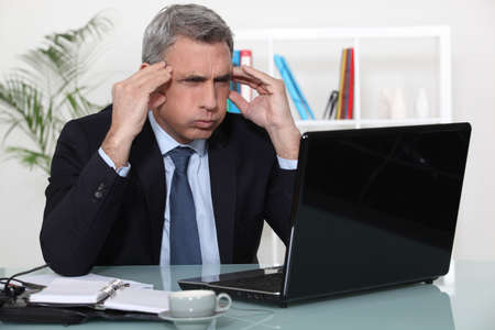 Man stressed with a laptop photo