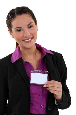 Woman displaying visitor badge photo