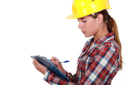 surveyor: Tradeswoman filling in paperwork Stock Photo