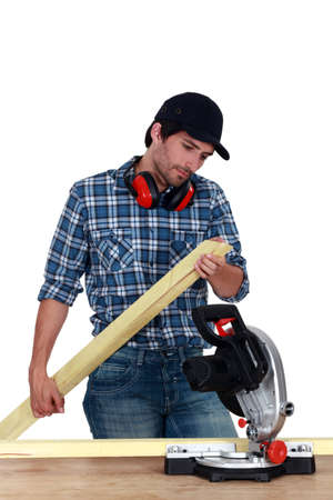miter: Carpenter inspecting planks of wood Stock Photo