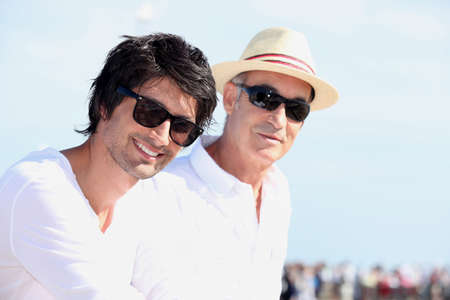 grown ups: Two men in white tops and sunglasses