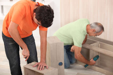 screw: Father and son assembling furniture