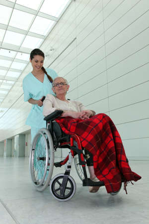 a nurse and an old lady in wheelchair photo