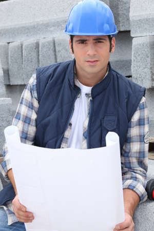 plot: Construction worker with building plans Stock Photo