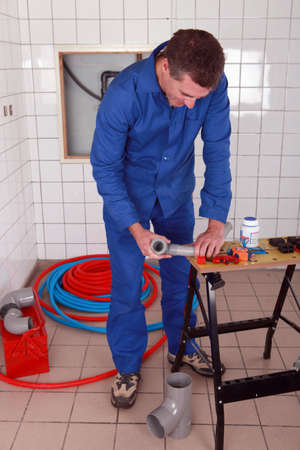 Plumber using a workbench photo