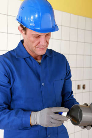 plumber changing a pipe Stock Photo - 11455981
