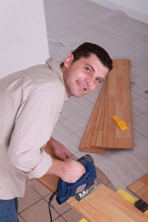 portrait of a man sawing photo