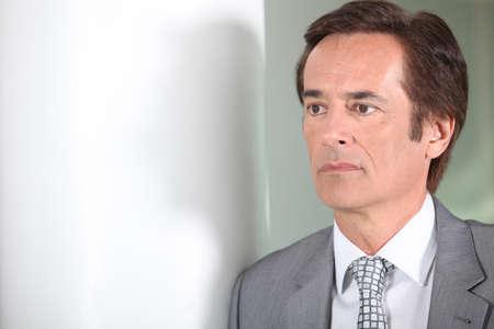 man 40 50: Businessman thinking. Stock Photo