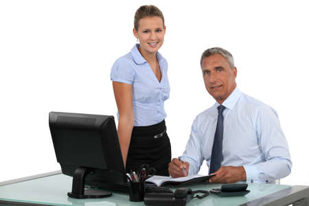 Boss working with female assistant photo