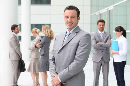 Group of business people stood outside building photo