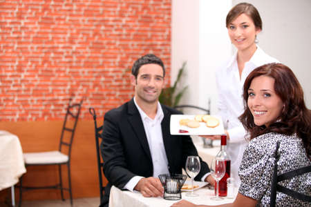 hospitality industry: Couple having a romantic meal together