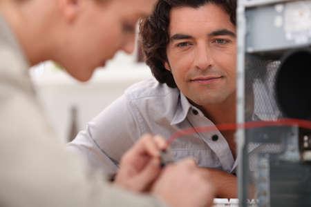 Woman repairing computer photo