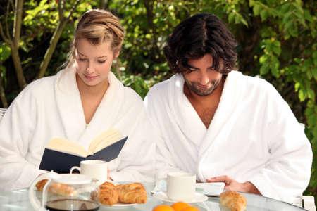 having a break: Couple having breakfast outside