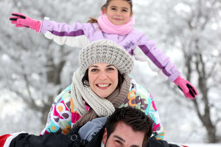 Family having fun outdoors on a cold winter photo