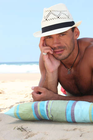 hairy chest: Man on the beach in a straw panama hat Stock Photo