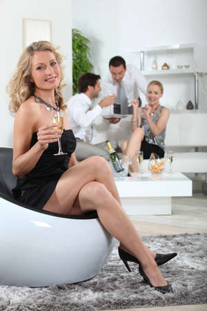 Woman holding glass of champagne photo