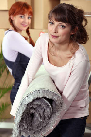 moving out: Mother helping her daughter on moving day Stock Photo