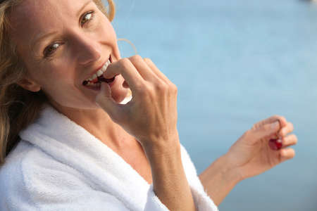 45 55 years: Woman eating cherries