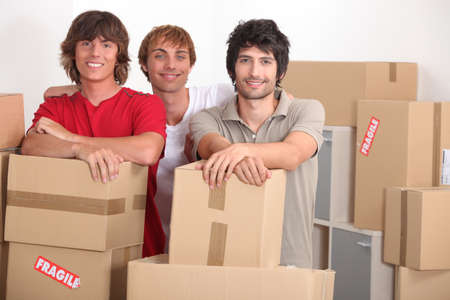 settling: Young men on moving day Stock Photo