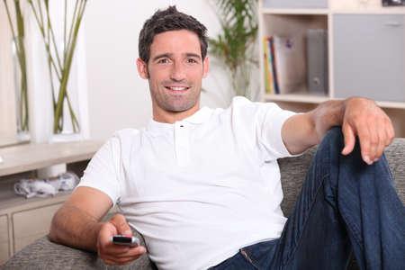Man relaxing on sofa photo