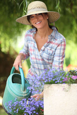 straw hat: lady watering flowers