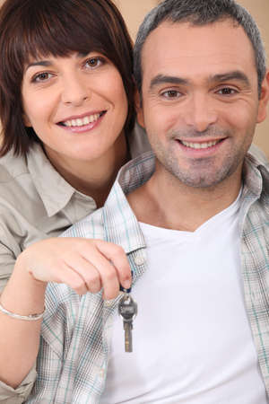 mid life: Mid life couple with the keys to their new home