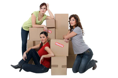 roommates: Young women posing with their belongings on moving day