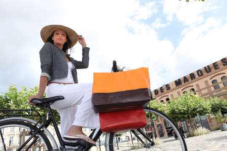 Low-angle shot of a woman on her bicycle Stock Photo