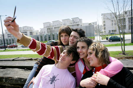 Group of teenagers hanging out on bench Stock Photo - 11456123