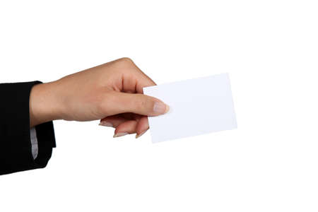 hand holding paper: female hand giving business card
