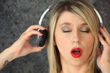 woman eyes shut listening to music photo