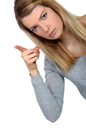 dissuade: Stern young woman pointing
