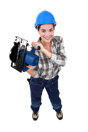 Tradeswoman holding a circular saw photo