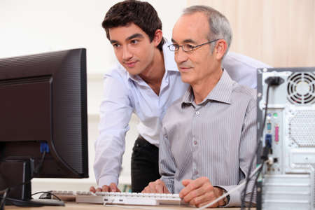 Computer technician helping office worker Stock Photo - 11455974