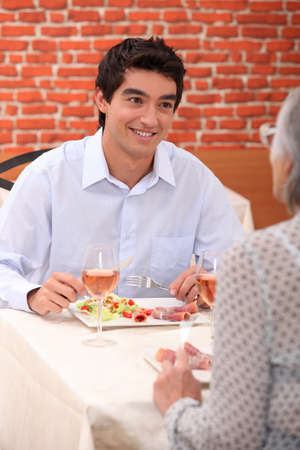 a boy and his grandmother at restaurant photo