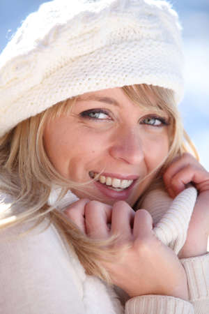 Woman snuggling up to her warm clothes Stock Photo - 11456332