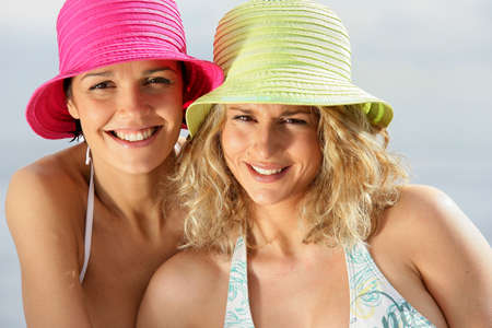 Two women wearing bikinis and hats photo
