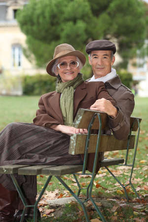 Older couple sitting on a bench photo