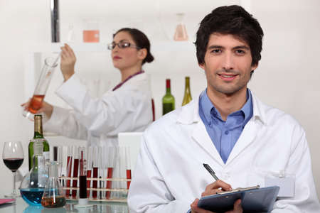 wine testing: Two scientists in wine testing facility