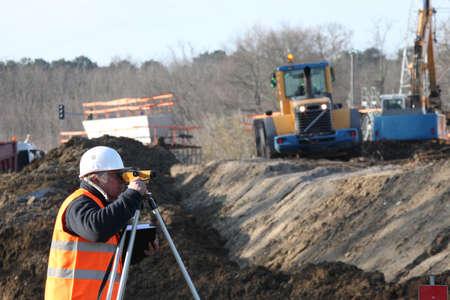 teodolito: Surveyor en el sitio