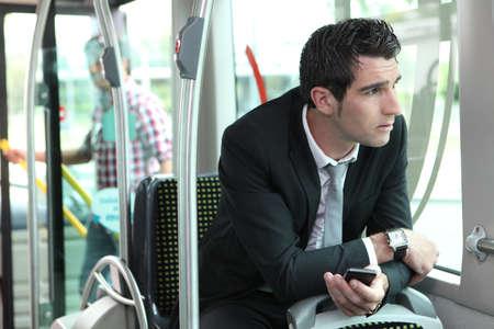 Man riding tram to work Stock Photo - 11603579
