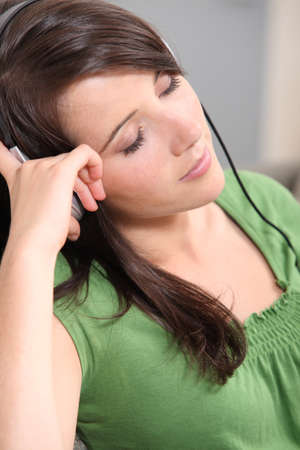 belle: brown-haired girl listening to music Stock Photo