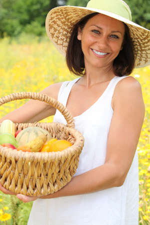 Woman with basket of fruit photo